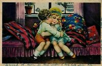 Illustratore BERTIGLIA PC Viaggiata Bambini si baciano su Sofà