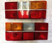 Volvo 240 244 Tail Light set pair with CHROME center trim 1986-93 MADE IN EUROPE