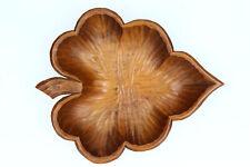 A vintage hand carved wooden bowl Leaf shaped