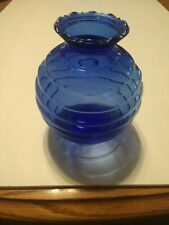 Royal blue vase shaped like a bee hive with scalloped edge on rim.