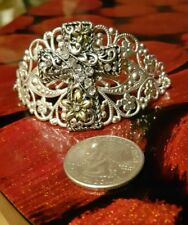 Silver tone filigree bracelet with rhinestones decorated cross