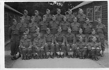 VINTAGE POSTCARD.WORLD WAR 11 ARMY GROUP HUTS SEARGENT BATTLEDRESS RP