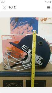 Slazenger Junior cricket helmet used - 20cm by 20cm.