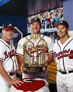 1995 World Series Champs Glavine Smoltz  Maddux With Trophy Braves 8 X 10 Photo