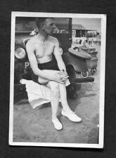 C1930s Photo: Man in Swimming Trunks Sitting on Car Bumper