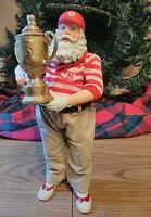 Vintage Possible Dreams Christmas Santa Claus 2003. Holding a trophy.