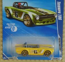 """EXCLUSIVE KMART COLOR HW 2010 """"FASTER THAN EVER"""" TRIUMPH TR6 IN YELLOW"""