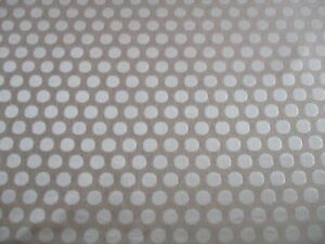 ROLL END OF 5 METRES OF A CIRCULAR SPOT DESIGN UPHOLSTERY FABRIC IN GOLD & CREAM