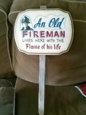 An old Fireman lives here with the flame of his life sign with stake