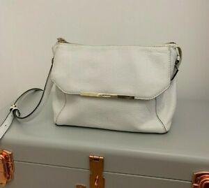 White leather DKNY small crossbody with zip pocket flap over small front pocket