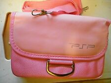 pink P S P games consolecarrying case