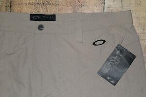 NWT OAKLEY GOLF Take Pants 2.0 421248 Khaki Beige Flat Front 40x35 NEW B35