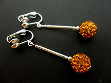 A PAIR OF DANGLY AMBER/YELLOW SHAMBALLA STYLE  SILVER PLATED CLIP ON EARRINGS.