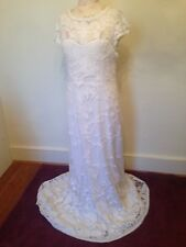 Beautiful Phase 8 lace long wedding dress. Unused. Brand new with tags. Size 14