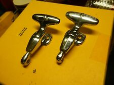 TWO 1957-56 THUNDERBIRD HARD TOP FRONT T HANDLE CLAMPS