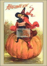 older postcard HALLOWEEN GIRL HOLDING CAT ON PUMPKIN sitting as a picture