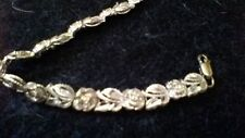 """Very nice silver bracelet roses all the way around 7 1/4"""" long"""