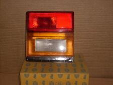 FARO FANALE POSTERIORE SX AUDI 100 dal 1982 HELLA Cod. 9EM126345-021 NUOVO