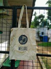 WECare Worldwide logo cream calico tote bag to help Sri Lankan street dogs