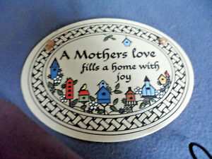 A pretty ceramic plaque from trinity pottery usa.a mother's love etc. 18.5x14cm