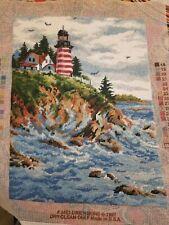Finished Needlepoint Lighthouse on the rocks