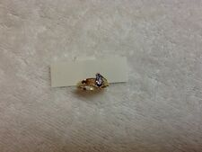 14kt yellow gold 0.54ctw marquise blue tanzanite & diamond accent ring size 6.75