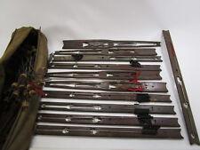 Vintage set of 11 Wooden ice fishing tip ups in Bag with metal/cork