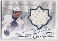 08-09 SIGNED ULTIMATE DEBUT THREADS NO SDT-RE ROBBIE EARL LEAFS WHITE JSY 02/35