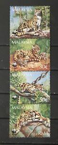 MALAYSIA # 541a. STRIP OF FOUR - NEOFELIS NEBULOSA TIGERS. WWF.   MNH