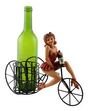 Pin-up Girl In Little Red Dress Riding Tricycle With Metal Wine Bottle Holder