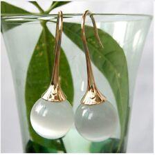 Navachi White Ball Opal Yellow Metal Hood Earrings