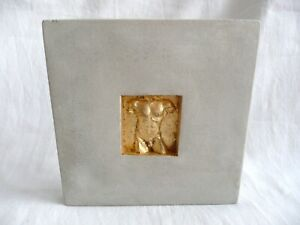 Small Stone Wall Plaque of a Naked Male Torso.