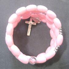 Rosary bracelet, pink plastic beads w silvery crucifix etc on memory wire wkb
