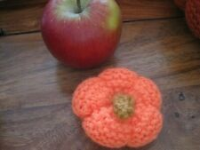 ONE TINY AUTUMNAL HALLOWEEN PUMPKIN. IN ORANGE AND HAND KNITTED.