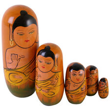 A Set Of 5 Wooden Russian Dolls In The Design Of A Thai Buddha.