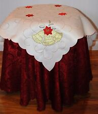 SMALL SQUARE CREAM TABLE CLOTH HAS APPLIQUE  GOLD COLOURED BELLS IN EACH CORNER