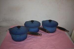 Three Blue Le Creuset Cast Iron Pans With Lids.