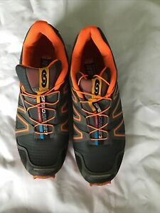 Mens Size 9 Walking/ Hiking/running Shoes  By Salomon