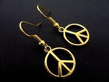 A PAIR OF  GOLD TONE DANGLY   PEACE SIGN EARRINGS. NEW.