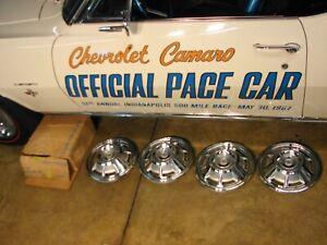 1967 67 CAMARO NOS GM 14 INCH HUBCAPS pt #986878
