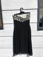 Review dress in black with a black lace top in size 10