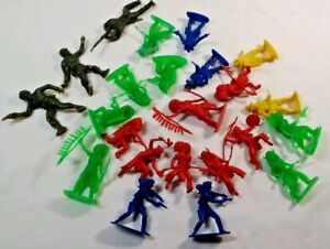 20 plastic western figures  & 3 green army  Used  no markings