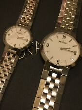 His and Hers Movado Faceto watches. Stainless Steel and White Dial. Swiss made.