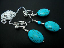 A SILVER PLATED OVAL TURQUOISE BEAD  NECKLACE AND CLIP ON EARRING SET. NEW.