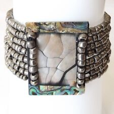 ABALONE SHELL BRACELET ELASTICATED. RAINBOW SHELL FRAME WITH SILVER GREY BEADS