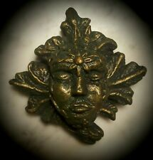 Green man wall plaque leaf face