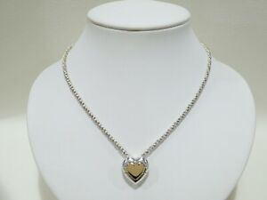 TIFFANY & CO. sterling silver / 18k yellow gold Puzzle Heart pendant necklace