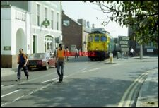 PHOTO  CLASS 33 LOCO  TRAIN THREADS ITS WAY THROUGH THE STREETS OF WEYMOUTH FROM