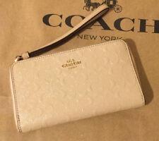Coach Debossed Signature Phone Wallet Patent Leather Platinum F57469