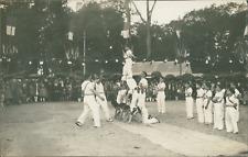 Pyramide d'acrobates enfants, 1935  Vintage silver print. Postcard paper.